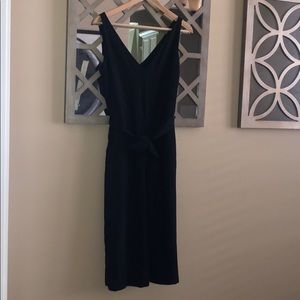Black romper with pockets.